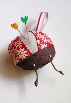 "Looking for a quick fix? This pincushion is the perfect answer for Mother's Day or when you need to make a little somethingsomething to give to a crafty friend. It's so super easy you'll squeal! (And not in a ""Eek, it's a bug and it's flying at my face"" kind of way)."
