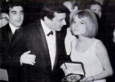 "France Gall  France Gall in 1965 receiving her gold Eurovision Song Contest award for ""Poupee de Cire, Poupee De Son"" (Wax Doll, Singing Dol..."