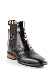 This Particular DeNiro short Riding Boot features a rear zipper with a top zip guard.  It comes in a beautiful black grain calfskin leather with a patent black and orange front detailed section with decorative laces.