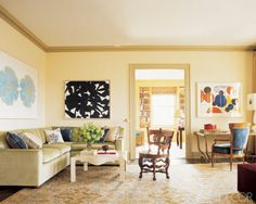 The living room of a young family's Manhattan apartment overlooking Central Park. The design was a collaboration between architect Peter Pennoyer and 2010 A-List designer Katie Ridder. A unique print by Andy Warhol, J.S. Flowers, and a painting by Jack Youngerman, Enigma, hang above a sofa upholstered in silk mohair by J. Robert Scott; the cocktail table by Urban has a faux-parchment finish. The carved Dutch Colonial Burgomaster chair is 17th century, the 1940s gilded-iron table is by ...
