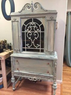 Beacon, NY stockist Knot Too Shabby displays a lovely cabinet finished in a colorwash of Duck Egg Blue, Old Ochre, and Coco Chalk Paint® by Annie Sloan.