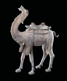 T'ang Large Terracotta Sculpture of a Camel - H.714 Origin: China Circa: 618 AD to 906 AD