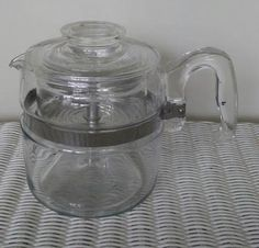 Check out this item in my Etsy shop https://www.etsy.com/listing/522570089/vintage-pyrex-coffee-pot-four4-cup