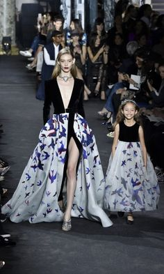 The show featured models and their mini-me's, who graced the runway in scaled down versions of their elaborate gowns.