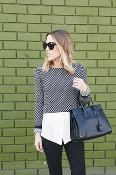 A modern take on the staple sweater/button down look, incorporating a crop top over the classic white button down.