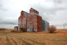 The grain elevators are a couple of the few things still standing in the ghost town of Arena, North Dakota ~  j_piepkorn65 @ flickr
