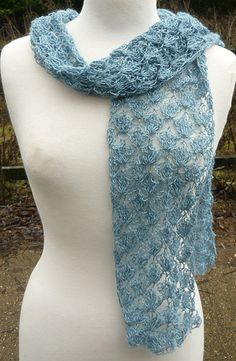 Free Crochet Angel Scarf Pattern. I love the lacey pattern of this scarf and it is blue, what could be wrong.