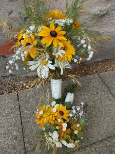 Bouquets supplied ready for the Bride & flower girl. DIY bucket of flowers provided for the 7 table centres