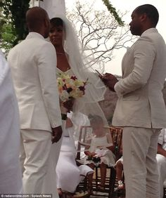 Tearful: Kelly appeared to be overcome with emotion as she exchanged vows with Tim on the big day