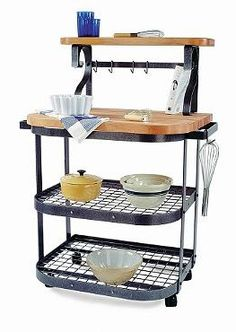 Easily provide your guests with a five-star dining experience with the versatile and handsome Baker's Cart; complete with maple butcher block top, utensil bar and shelves for convenience.