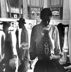 by Eve Arnold Self-Portrait in Distorted Mirror, 42nd Street, Broadway, New York, 1950