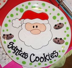 We love to bake cookies for Santa! My daughter puts them neatly on his plate and pours him some milk. We leave carrots for the reindeer and we ALWAYS sprinkle glitter and oats in our yard so Santa and the reindeer can see where to STOP!