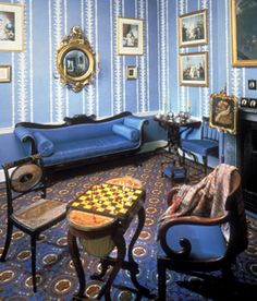 The Regency furniture style was elegant, particularly the chairs, which were usually low with curved backs, brass inlay and sabre legs.  Chaises lounges were popular, and the fashionable sofa was the Grecian couch, with roll-curved ends, bolster cushions and carved feet.