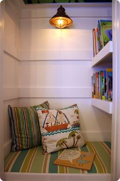 This old closet was transformed into a cute little reading nook for a budding book lover. The light is a nice touch!