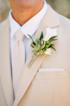 Lily and succulent groom's boutonniere // Acres of Hope Photography // Take the Cake Event Planning