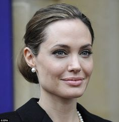 angelina jolie. summit G8. grey hair