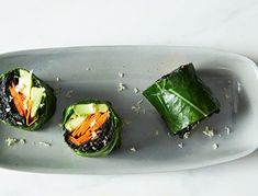 We love the ingenuity of this recipe, from the kale/collard greens combo, to the garlic, coconut, curry and orange filling. It's uniquely delicious, and the sushi roll presentation makes it perfect for a bento box lunch.