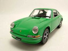 Whitebox Porsche 911 Diecast Model Car This Porsche 911 S Diecast Model Car is Green and features working wheels and also opening bonnet, boot with engine, doors. It is made by Whitebox and is scale (approx. Porsche 911 S, Porsche Models, Diecast Model Cars, Engine, Scale, Wheels, Doors, Vehicles, Green