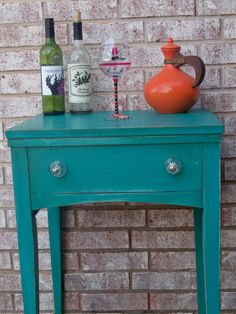 Sewing table that would make a cute accent table or small mini bar for an apartment.  Painted in Florence by ASCP.