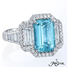 3.40 cts. Mozambique emerald-cut paraiba is accented with 1.42 ct. t.w. emerald-cut diamonds and 0.62 ct. t.w. trapezoid diamonds in this micropave platinum ring.     JB Star