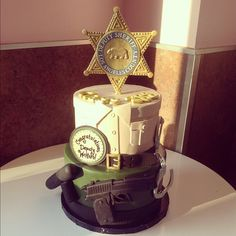 Congrats to Deputy Wetters on becoming a Sheriff! We hope we made your graduation extra special with this awesome cake! :) #congrats #deputy #cake by thecakemamas, via Flickr