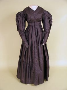 Black silk mourning dress, c. 1830's.  And it's front opening, which I can't find many examples of from this period.