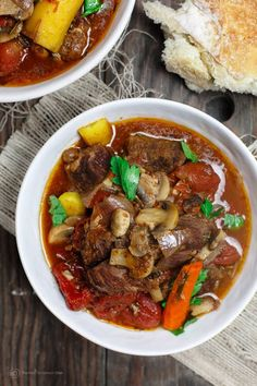 Easy and rustic Italian Beef Stew recipe. Slowly cooked in wine broth with aromatics and tomatoes, carrots, and mushrooms. Only 15 minutes to prep!