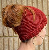 Free Knitting Pattern for Ponytail Holey Hat - This easy ponytail-friendly beanie is a quick knit in bulky yarn. Designed by SplitStitch Designs