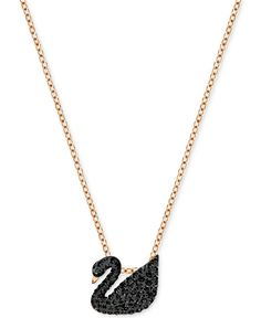"Explore the dark side with this ultra-elegant crystal pave black swan pendant necklace fashioned by Swarovski in rose gold-tone mixed metal. Approximate length: 14-7/8"". Approximate drop: 3/8"". 