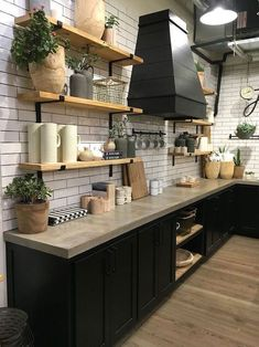 Beautiful farmhouse style kitchen at Magnolia Market. 5 Things to Know before you visit Magnolia Market Beautiful farmhouse style kitchen at Magnolia Market. 5 Things to Know before you visit Magnolia Market Kitchen Ikea, Black Kitchen Cabinets, Black Kitchens, Kitchen Interior, New Kitchen, Home Kitchens, Kitchen Dining, Kitchen Black, Kitchen Shelves