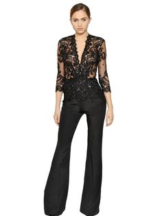 5cb6214c47 Shop embellished lace crepe jumpsuit from Zuhair Murad in our fashion  directory.
