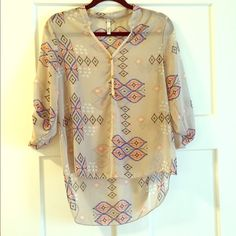 Sheer Blouse Aztec print, 3 quarter sleeve, high low hem. Only worn once. Yoyo Tops Blouses