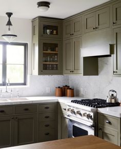Kitchen cabinets painted Pratt and Lambert Olive Bark with oil-rubbed bronze cabinet hardware #kitchen