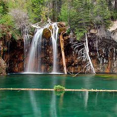 Colorado - Hanging Lake National Natural Landmark - I hiked up here, a mile straight up but oh so beautiful.  You can walk behind the waterfall and watch the water come down.