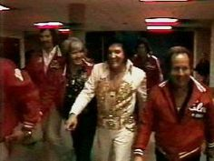 Elvis - with security team leaving his last live concert. June 26, 1977. Indianapolis, IN.