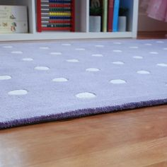 Polka dot nursery rug in soft lavender.