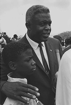 Jackie Robinson was a baseball legend and first African-American to play in Major League Baseball. After Jackie changed the world of baseball, he devoted himself to the Civil Rights movement. Here he is at the March on Washington with his son Dodgers, National Baseball League, National League, Jackie Robinson, Black History Facts, Civil Rights Movement, African Diaspora, My Black Is Beautiful, Before Us