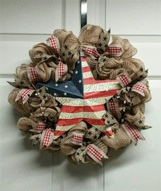 This patriotic wreath can be used many time thought the year, Memorial Day, 4th of July, and for Labor Day. It is made with high quality burlap mesh and decorated with a rustic patriotic star and corrdinating ribbons.  This wreath measures approximately 18 inches in diameter.