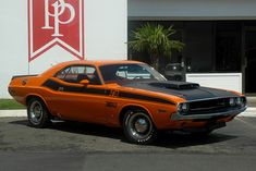1970 Dodge Challenger T/A 340 Six-Pack. Mopars aren't my favorite, but the Go Mango paint with black graphics looks pretty damn cool.