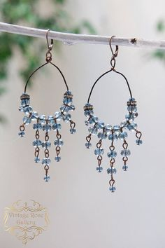 Boho Chic Earrings -Denim Blue Earrings - Bohemian Earrings - Statement Earrings- Chandelier Earrings - Artistic Earrings Features different shades and shapes of denim blue sparkling crystals beads , antique rhinestones and antique bronze wire . With copper lever back ear hooks.