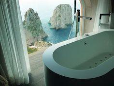 World's Best Hotel Bathroom Views Hotel Punta Tragara in Capri, Italy, features awe inspiring views of the Faraglioni from the oversized bath of the Punta Tragara Art Suite.