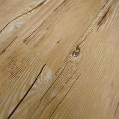 Vinyl plank glue-down flooring - this would be great for a basement and on sale for $2.49sq.ft.  Many different patterns.