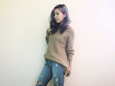 knitted pullover and ripped denim jeans for work