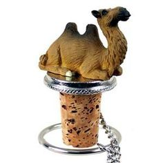 """Camel Bottle Stopper by Conversation Concepts. $11.95. A pewter based cork bottle stopper with a 2"""" camel designed to fit any standard size bottle or your favorite wine.  Comes with it's own velvet drawstring pouch, perfect for gift giving!  Total height of bottle buddy is approximately 3 1/2"""" high.  We have over 198 animal theme bottle stoppers to choose from or add to your collection!"""