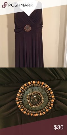 Brown Sundress Chocolate brown sundress with a decorative pendent. New w/o tags. Never been worn. Dresses Midi