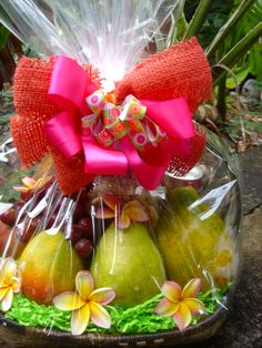 Our Healthy Basket w/Fresh Seasonal Fruit includes: Unsalted Macadamia Nuts, Cranberry Oatmeal Cookies, Tropical Juice, Tropical Trail Mix, and 8-9 pieces of fresh fruit (papaya, mango, apple-bananas, pear, apple, lychees, orange).  A cute gift basket for any occasion. Price: $55.00  EXQUISITE BASKET EXPRESSIONS -O'ahu, Hawaii