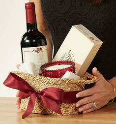 Love this hostess gift basket idea...nice wine, candle, and chocolates in a reusable basket..perfect gift for dinner or parties