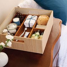 Toiletries for overnight guests in a nice box with some seasonal or local touches (candy, candles, ornaments, etc.) that they can take home to remember their stay.