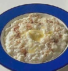 Risengrynsgrøt, a type of rice porridge.  Very creamy and delicious with cream, sugar and cinnamon or cardamom.  At Christmas after eating a ton of turkey, bowls of risengrynsgrøt are brought out and you must eat and eat until someone finds the almond that is hidden in the pot.  The winner gets a marzipan pig!!!  For English translation google risgrot and you'll find some good ones.