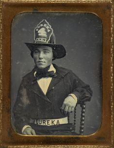 Quarter-plate daguerreotype of a fireman, with EUREKA inscribed on his hat and belt;